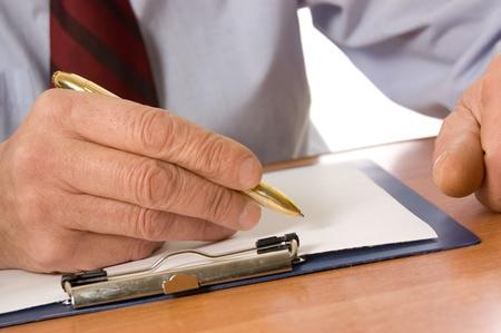 fills: The businessman fills the document