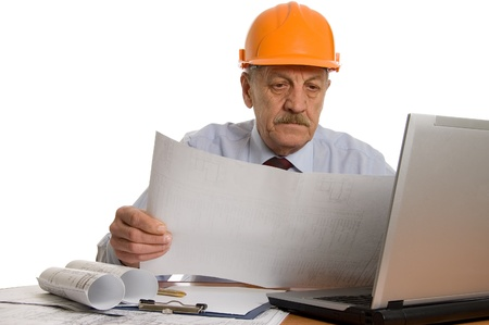 Engineer at the computer isolated on white background Stock Photo - 8834563