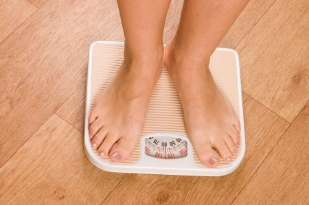 Female feet on scales photo