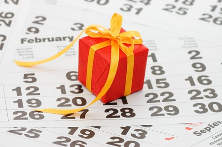 Box with a gift on calendar sheet - - Valentines day photo