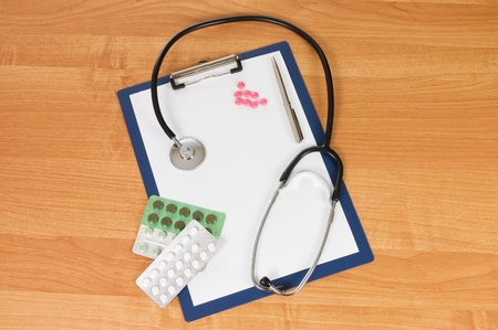 blank clipboard with modern stethoscope photo