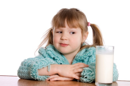 The little girl with a milk glass photo