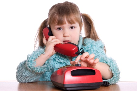 The little girl speaks by phone Stock Photo - 8834911