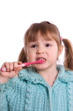 The little girl cleans a teeth photo