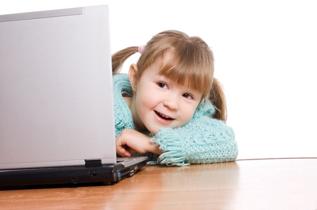 The little girl at the computer photo