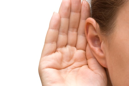 blab: Girl listening with her hand on an ear Stock Photo