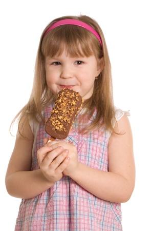 The little girl eats ice-cream photo