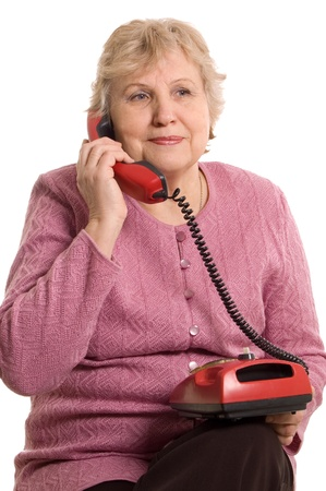 The elderly woman speaks on the phone Stock Photo - 8926304
