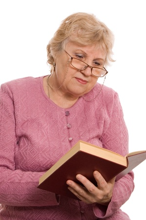 reading glasses: The elderly woman reads the book