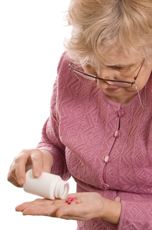 The elderly woman with tablets photo