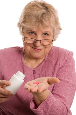 The elderly woman with tablets Stock Photo - 8926082