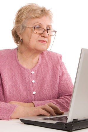 The elderly woman at the computer Stock Photo - 8926261