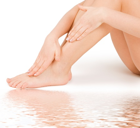woman massage feet in water isolated on white background Stock Photo - 8926041