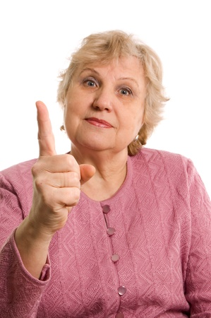 threatens: The elderly woman threatens with a finger