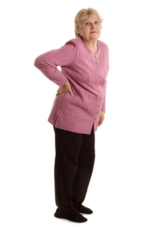 leans on hand: The elderly woman with a pain in a back Stock Photo
