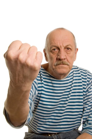 impatient: The elderly man threatens with a fist Stock Photo