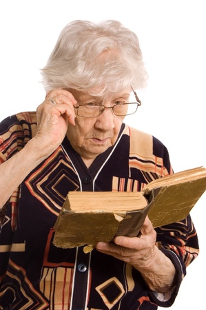 The elderly woman reads the book photo