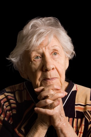 Portrait of the old woman a black background Stock Photo - 9035743