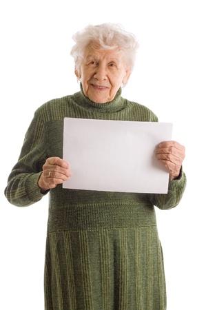 grandmas: Retrato de una mujer senior feliz celebraci�n de billboard en blanco sobre fondo blanco Foto de archivo