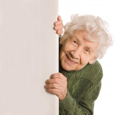 vieux: Les vieux espions de femme isol�es sur fond blanc Banque d'images
