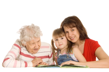 The grandmother with the grand daughter read the book photo