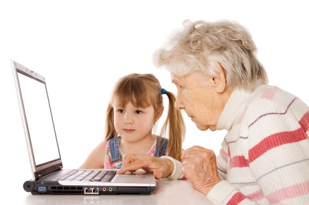 The grandmother with the grand daughter at the computer photo