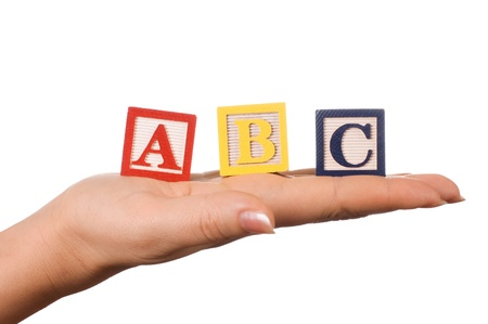 The hand holds a cube with letters photo