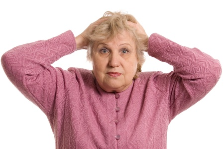 keeps: The elderly woman keeps for a head Stock Photo