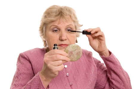 The elderly woman does a make-up photo