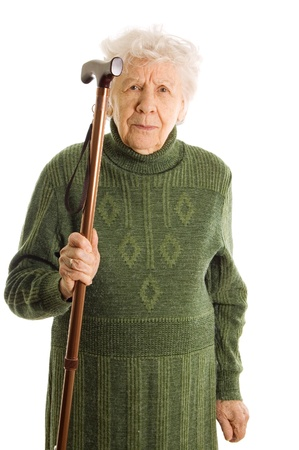 Grandmother holding a cane on white background photo