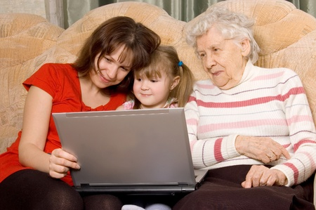 Family on a sofa with the computer photo