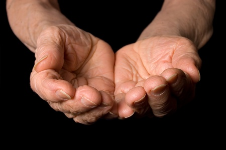Hands of the old woman on a black background Stock Photo - 9097774