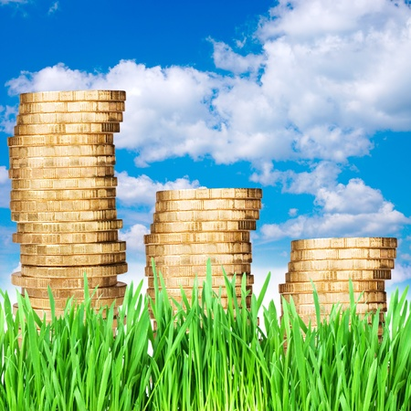 Gold coins against the sky photo