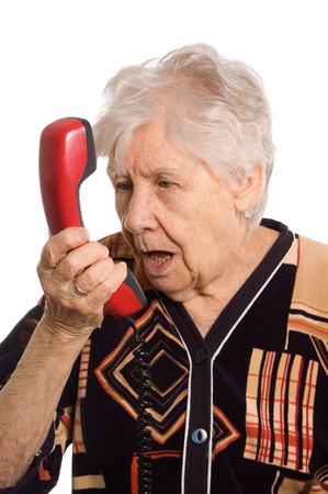 The elderly woman speaks on the phone Stock Photo - 9258802