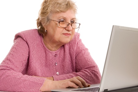 The elderly woman at the computer photo