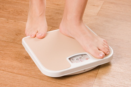 weight scales: Female feet on scales Stock Photo
