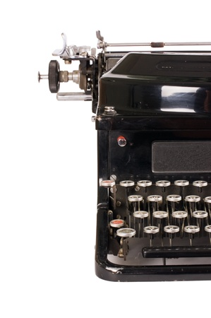 Old typewriter isolated on white background photo