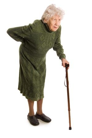 elderly pain: Nonna in possesso di un bastone su sfondo bianco