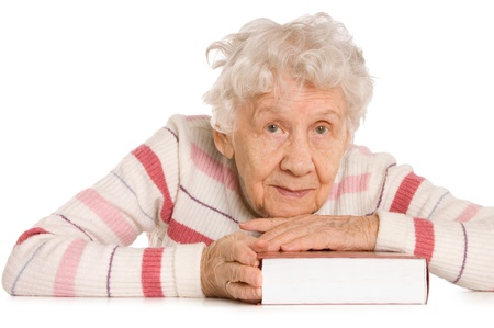 wise woman: The elderly woman reads the book