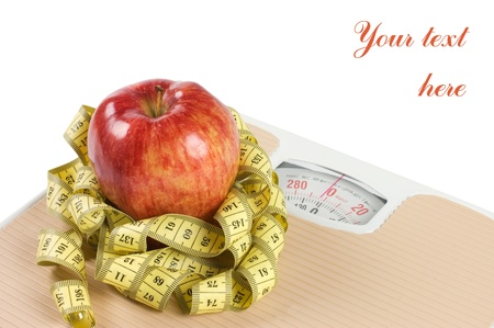 Scale, tape and apple on white background Stock Photo - 9318326