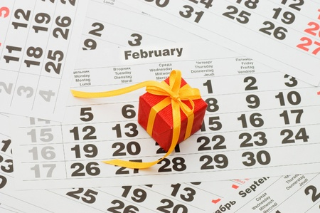 Box with a gift on calendar sheet - Valentines day Stock Photo - 9318325