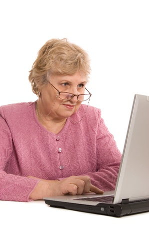 The elderly woman at the computer Stock Photo - 9318226