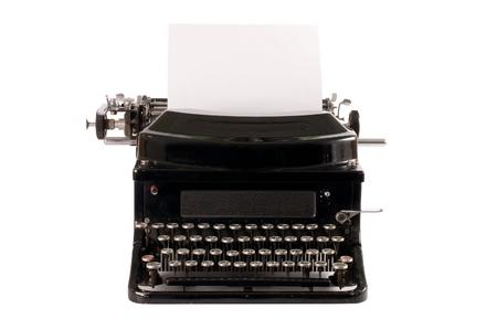 outmoded: Old typewriter isolated on white background