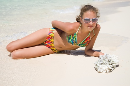 The beautiful girl at the sea photo