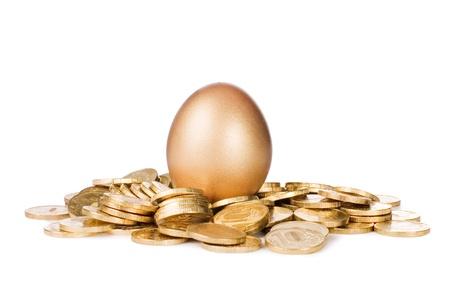 Gold egg in golden coins isolated on white Stock Photo - 9412799