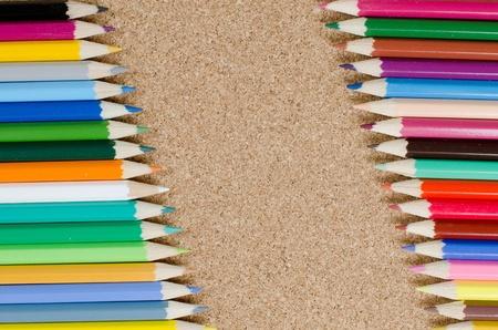 Colour pencils on ñorkboard Stock Photo - 9412925