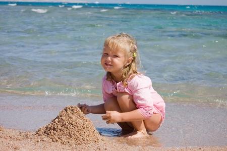 The little girl on seacoast photo