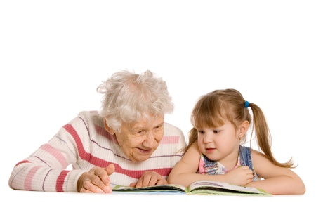 Grandmother with the grand daughter read the book photo