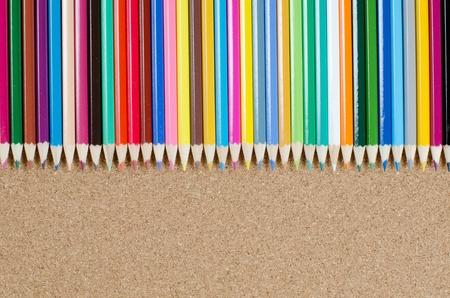 Colour pencils on �orkboard Stock Photo - 9457987
