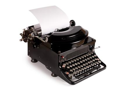 typewriter: M�quina de escribir antigua aislada sobre fondo blanco